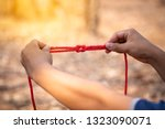 scout knot learning in forest... | Shutterstock . vector #1323090071