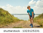 athletic young jogging man... | Shutterstock . vector #1323125231