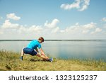 athletic young man doing... | Shutterstock . vector #1323125237