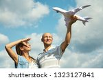 portrait of a couple outdoors... | Shutterstock . vector #1323127841