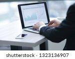 businessman working on laptop... | Shutterstock . vector #1323136907
