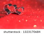 hearts on red glitter with bokeh | Shutterstock . vector #1323170684