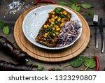 delicious pork ribs on wooden... | Shutterstock . vector #1323290807