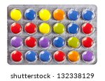 Blister with multi colored pills on white background - stock photo