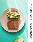 avocado on toast on a plate | Shutterstock . vector #1323431717