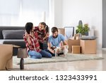 happy family after moving into... | Shutterstock . vector #1323433991