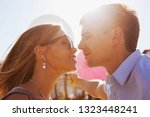 loving couple passionately look at each other at sunset, photo for Valentine's Day