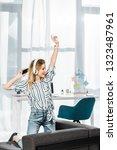 blissful girl in striped shirt... | Shutterstock . vector #1323487961