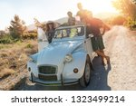 group of happy friends in a car ... | Shutterstock . vector #1323499214