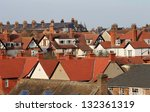 Red Roof Tops On Modern Housin...