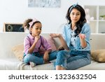serious african american mother ... | Shutterstock . vector #1323632504