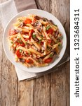 serving penne pasta with pulled ... | Shutterstock . vector #1323684311