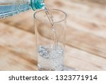 sparkling water is poured into... | Shutterstock . vector #1323771914