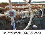 Close-up of the steering wheel and speedometer in the cabin of an old rusty pickup truck, Rhodes Island, Greece