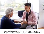 male doctor in office... | Shutterstock . vector #1323805337