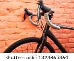 a black race bike in front of... | Shutterstock . vector #1323865364