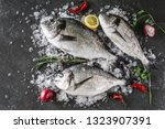 fresh raw dorado fishes with... | Shutterstock . vector #1323907391
