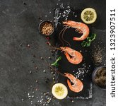 fresh raw prawns or boiled red... | Shutterstock . vector #1323907511