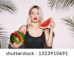 girl with red lips posing at... | Shutterstock . vector #1323910691