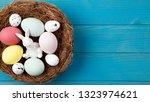 happy easter nest blue wooden... | Shutterstock . vector #1323974621