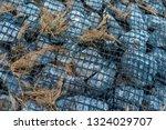 ruins of gabion   mattress... | Shutterstock . vector #1324029707
