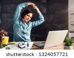 business woman wearing denim... | Shutterstock . vector #1324057721