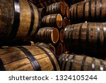 rows of alcohol barrels in... | Shutterstock . vector #1324105244