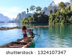 boat on a mountain lake in... | Shutterstock . vector #1324107347