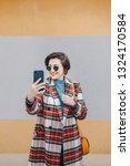 portrait of pretty  modern... | Shutterstock . vector #1324170584