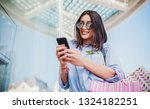woman in shopping. smiling... | Shutterstock . vector #1324182251
