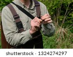 man putting a worm on hook for... | Shutterstock . vector #1324274297