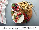 plain yougurt with granola and... | Shutterstock . vector #1324288457