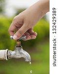woman hand shut the faucet ...   Shutterstock . vector #132429389