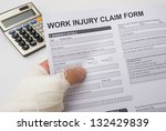 hurted hand holding a work... | Shutterstock . vector #132429839