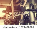 working out with dumbbell... | Shutterstock . vector #1324428581