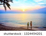 mother and son on tropical beach | Shutterstock . vector #1324454201