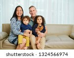 mixed race family of four... | Shutterstock . vector #1324566974