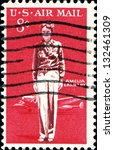 Small photo of USA - CIRCA 1963: A stamp printed in United States of America shows Amelia Earhart and Lockheed Electra, circa 1963