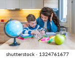 mom helping her son do his... | Shutterstock . vector #1324761677