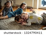party at home. four little... | Shutterstock . vector #1324790411