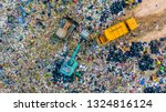 Small photo of Garbage pile in trash dump or junkyard, Aerial view garbage metal truck unload garbage consumption junkyard scarp, Global warming, Ecosystem and healthy environment concepts and background.