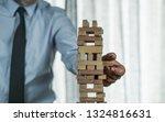 business man tower  risk concept | Shutterstock . vector #1324816631