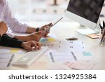 ux designer team using tablet...