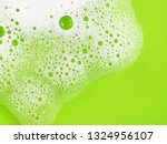 Soap Sud On Green Background....