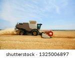 agricultural harvester working... | Shutterstock . vector #1325006897