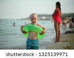 boy playing on the public city... | Shutterstock . vector #1325139971