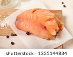 salmon with on wooden chopping... | Shutterstock . vector #1325144834
