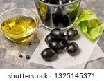 black olives  glass bowl with... | Shutterstock . vector #1325145371