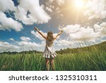 young beautiful woman on green... | Shutterstock . vector #1325310311