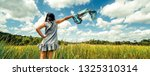 young beautiful woman on green... | Shutterstock . vector #1325310314
